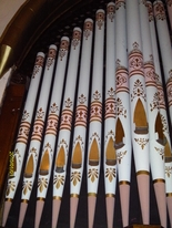 The Olde North Chapel's original organ pipes, lovingly restored and hand painted.