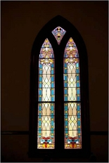 One of the historical stained glass window designs at The Olde North Chapel, an historical wedding chapel in Richmond, Indiana