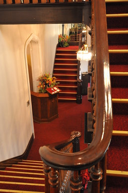 Double staircase in the foyer of Historic Indiana Wedding Venue, The Olde North Chapel, Richmond, Indiana