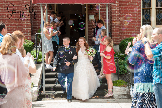 exterior of wedding chapel venue in Richmond, Indiana Dress Blues Bride groom wedding bubbles